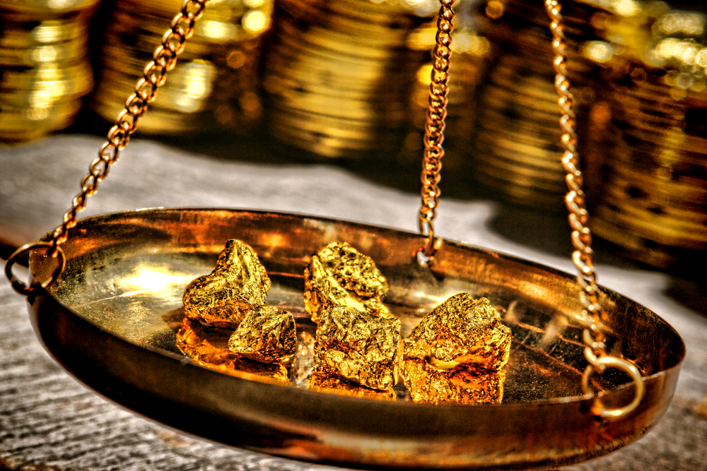 Gold prices held back by strong dollar headwinds