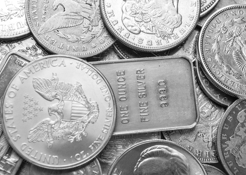 Silver surrenders gains to join gold's retreat